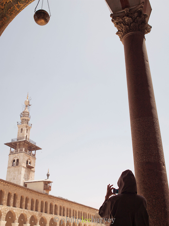 A worshipper takes a photograph in the Umayyad Mosque, the Grand Mosque of Damascus, Damascus, Syria