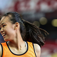 Samantha Theresa Ortega (#87) celebrates after anchoring Singapore Sports School to win the C Division girls' 4x100m final. (Photo © Lim Yong Teck/Red Sports)
