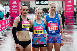 The winner of the women's race Charlotte Purdue (centre) alongside second placed Lily Partridge (left) and third placed Charlotte Arter (right) during the Vitality Big Half in London City Centre.
