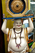 Statue of smiling Buddha in Little India, Singapore