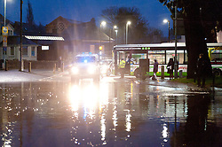 © Licensed to London News Pictures. 30/11/2015. Builth Wells, Powys, Wales, UK. Large traffic jams on the A483 at Builth Wells are caused when the river Wye bursts it's banks and floods this busy road at rush hour. Photo credit: Graham M. Lawrence/LNP