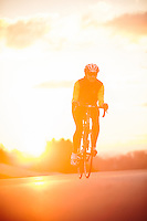 .Photos by Sam Dean  .Triathlete Nancy Hans during morning bike ride in Salem..snow run