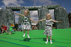 © licensed to London News Pictures. London, UK 21/07/2012. Mia and Sophie, 5 year-old twins enjoying Jeremy Deller's life-size bouncy castle version of Stonehedge, entitled Sacrilege which comes to London as a part of the London 2012 Festival on 21/07/12. Photo credit: Tolga Akmen/LNP