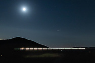The moon shines over the Moodna Viaduct railroad trestle and Schunnemunk Mountain in Cornwall, N.Y., on Nov. 20, 2020. The image is a combination of exposures at the train crossed the trestle.