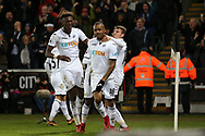 Jordan Ayew of Swansea city (c) celebrates with his teammates Tom Carroll ® and Tammy Abraham (l) after he scores his teams 1st goal to make it 1-1.  Premier league match, Swansea city v Crystal Palace at the Liberty Stadium in Swansea, South Wales on Saturday 23rd December 2017.<br /> pic by  Andrew Orchard, Andrew Orchard sports photography.