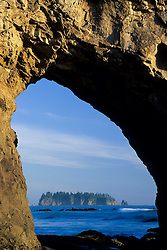 North Amercia, Washington, island viewed through arch in sea stack, Rialto Beach, Olympic National Park
