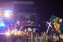 © Licensed to London News Pictures . 21/07/2014 . Nottinghamshire , UK . Fire crew and lorries at the scene . Police , fire crew and ambulances on the A1 road in Ranby yesterday morning (21st July 2014) following a fatal multi vehicle accident . Leroy and Sheila Carrington (aged 68 and 58) died at the scene when the Peugot 206 they were driving collided with a Vauxhall Astra . Roderick Franks (58) , who was a passenger in the Astra , died in hospital , following the crash . The road was closed in both directions whilst police investigated the scene .  Photo credit : Joel Goodman/LNP