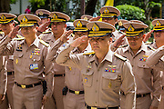 09 OCTOBER 2014 - BANGKOK, THAILAND: Officers of the Royal Thai Navy salute before praying for Bhumibol Adulyadej, the King of Thailand at Siriraj Hospital. The King has been hospitalized at Siriraj Hospital since Oct. 4 and underwent emergency gall bladder removal surgery Oct. 5. The King is also known as Rama IX, because he is the ninth monarch of the Chakri Dynasty. He has reigned since June 9, 1946 and is the world's longest-serving current head of state and the longest-reigning monarch in Thai history, serving for more than 68 years. He is revered by the Thai people and anytime he goes into the hospital thousands of people come to the hospital to sign get well cards.  PHOTO BY JACK KURTZ