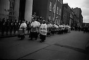 Archbishop Ryan Installed as Archbishop of Dublin..1972..27.02.1972..02.27.1972..27th February 1972..The installation of the Most Rev Dr Dermot Ryan as Archbishop of Dublin took place in The pro Cathedral,Dublin on Sunday 27th Feb 1972..Image of members of the Irish clergy as they proceed towards the Pro Cathedral for the installation of Dr Ryan as Archbishop. A guard of honour was provided by the Irish Girl Guides and The Irish Boy Scout associations. view,
