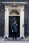 An Asian Policeman on the door step of number 10 Downing Street, London. Home of the British Prime Minister.