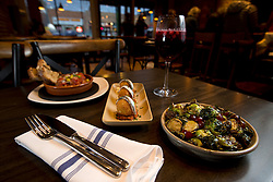 Tapas at La Marchas Tapas Bar include meatballs, from left, deep fried cod fish balls, and Brussells sprouts, accompanied by housemade sangria, photographed Wednesday, Jan. 13, 2016, in Berkeley, Calif. (Photo by D. Ross Cameron)