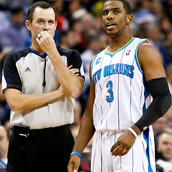 December 17, 2010; New Orleans, LA, USA; New Orleans Hornets point guard Chris Paul (3) talks to an official during the first half of a game against the Utah Jazz at the New Orleans Arena.  The Hornets defeated the Jazz 100-71. Mandatory Credit: Derick E. Hingle