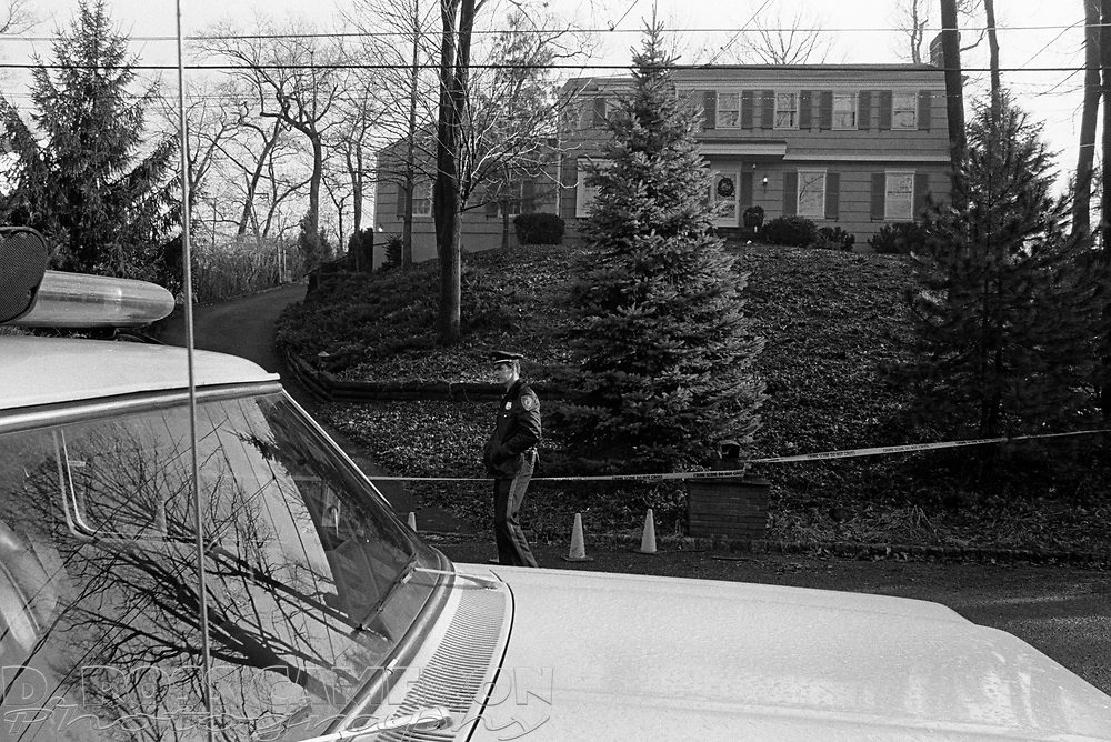 A police officer stands watch outside the Huron Drive house where Gail Dreher was discovered murdered, Jan. 3, 1986 in Chatham, N.J. Mrs. Dreher's body was discovered by her husband John when he returned home from work Jan. 2. (D. Ross Cameron/North Jersey Advance)