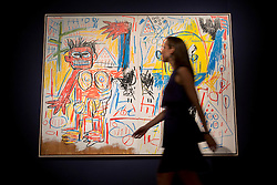 © licensed to London News Pictures. London, UK 21/06/2013. 'Untitled' by Jean-Michel Basquiat being prepared ahead of Christie's upcoming Post-War & Contemporary Art Evening Auction which will take place on June 25, 2013. Auction features with works by Basquiat, Doig, Liechtenstein and Warhol and total estimate is £56-72 million. Photo credit: Tolga Akmen/LNP