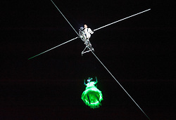 "© Licensed to London News Pictures.  24/01/2015. Bristol, UK.  ""Bridging the Gap"", the launch of Bristol Green Capital 2015 at the Create Centre in Bristol.  Tight wire artist Jade Kindar-Martin cycled across a 120m high wire 27m above the ground between two warehouses (one of which is the Create Centre) with Hollywood stuntwoman Karine Mauffrey performing an aerial trapeze routine suspended beneath the bicycle. There were also other performers with led lit umbrellas, and singers.  Photo credit : Simon Chapman/LNP"