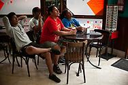 Peruvian football fans watch their national team's Russia 2018 World Cup Group C match against France in a bar. Irun (Basque Country). June 21, 2018. (Gari Garaialde / BostokPhoto)