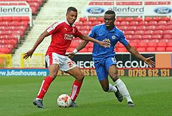 Gabriel Zakuani of Peterborough United closes down Jermaine Hylton of Swindon Town - Mandatory byline: Joe Dent/JMP - 07966 386802 - 10/10/2015 - FOOTBALL - County Ground - Swindon, England - Swindon Town v Peterborough United - Sky Bet League One
