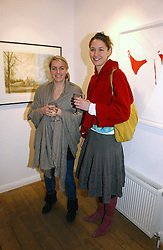 Left to right, LAURA LOPES daughter of HRH The Duchess of Cornwall  and her sister in law MIMA LOPES at a private view of 'Works on Paper' by various artists held at Eleven, 11 Eccleston Street, London SW1 on 10th January 2007.<br />