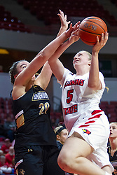NORMAL, IL - October 30: Lexy Koudelka hacked on a shot by Ellen McCorkle during a college women's basketball game between the ISU Redbirds and the Lions on October 30 2019 at Redbird Arena in Normal, IL. (Photo by Alan Look)