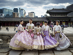 October 10, 2018 - Seoul, Gyeonggi, South Korea - South Korean girls wearing ''Hanbok'' style clothing at Gyeongbokgung Palace in Seoul. Hanbok is traditional Korean clothing, originally popular in the late Joseon dynasty, before the Japanese conquest of Korea. It is known for vibrant colors and simple lines without pockets. The term literally means ''Korean clothing'', but hanbok usually refers specifically to clothing of the Joseon period. The South Korean government encourages people to wear Hanbok clothing to festivals and cultural celebrations and some museums give free admiccion to people wearing Hanbok clothing. (Credit Image: © Jack Kurtz/ZUMA Wire)