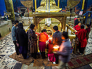 07 MARCH 2017 - KATHMANDU, NEPAL: People make offerings at the Kamaladi Ganesh Temple, the most important Hindu temple dedicated to Ganesh, known as the overcomer of obstacles, in Kathmandu. In Hindu theology, Tuesdays are the best day to pray to Ganesh and the temple is very busy on Tuesdays. People frequently visit temples dedicated to Ganesh when they buy a new home or start a new job.     PHOTO BY JACK KURTZ