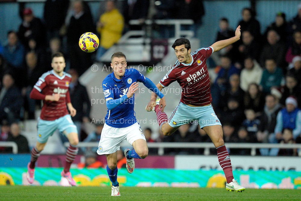 Jamie Vardy of Leicester City and James Tomkins of West Ham United chasing for the ball. Barclays Premier league match, West Ham Utd v Leicester city at the Boleyn ground, Upton Park in London on Sat 20th December 2014.<br /> pic by John Patrick Fletcher, Andrew Orchard sports photography.