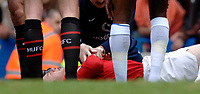 Photo: Daniel Hambury.<br />Chelsea v Manchester United. The Barclays Premiership. 29/04/2006.<br />United's Wayne Rooney lies injured on the pitch.