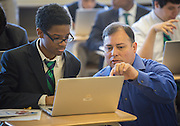 Students at Young Men's Preparatory Academy receive their new laptops during a PowerUp deployment, October 17, 2013.