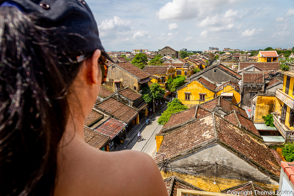 Oct. 2020, Hoi An: A View old Ancient Town from the shoulders of a Vietnamese woman. RAW to Jpg.