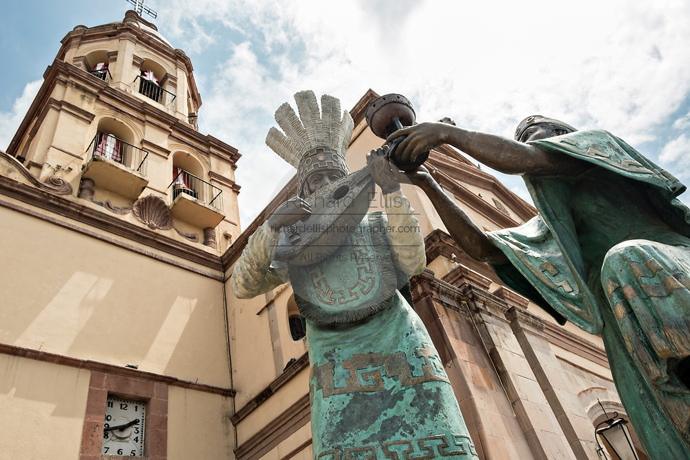 Statue of Otomi Indians outside the Holy Cross Church and Franciscan Convent also called the Templo y Convento de la Santa Cruz on Founders Plaza in the old colonial section of Santiago de Queretaro, Queretaro State, Mexico.