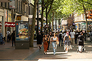 As the coronavirus restrictions continue and the government is about to announce an extension to the original freedom day planned for June, slowing the process of easing, more and more people begin to come to the city centre, seen here on New Street on 15th June 2021 in Birmingham, United Kingdom. After months of lockdown, the first signs that life will start to get back to normal continue, with more people enjoying the company of others in public, while uncertainty continues for a projected further month, which is being dubbed The final push.