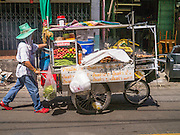 "05 OCTOBER 2012 - BANGKOK, THAILAND: A street food vendor pushes his cart along a soi (small street) in Bangkok, Thailand. Thailand in general, and Bangkok in particular, has a vibrant tradition of street food and ""eating on the run."" In recent years, Bangkok's street food has become something of an international landmark and is being written about in glossy travel magazines and in the pages of the New York Times.       PHOTO BY JACK KURTZ"