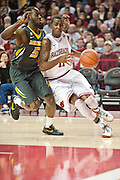 Feb 16, 2013; Fayetteville, AR, USA; Arkansas Razorbacks guard BJ Young (11) drives around Missouri Tigers guard Keion Bell (5) during a game against the Missouri Tigers at Bud Walton Arena. Arkansas defeated Missouri 73-71. Mandatory Credit: Beth Hall-USA TODAY Sports