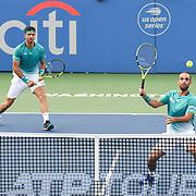 ROBERT FARAH and JUAN SEBASTION CABAL hit a volley at the Rock Creek Tennis Center.