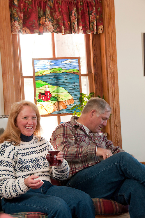 Guests of the Big Bay Lighthouse Inn relax in the library and dining room of the historic structure in Big Bay Michigan.