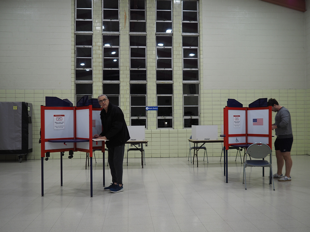 Early morning Virginia voters cast their ballots on Presidential Primary Day.