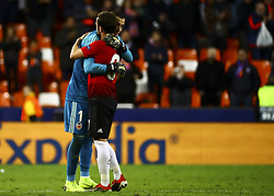 December 12, 2018 - Valencia, Spain - Juan Mata of Manchester United  (R) and Jaume Domenech of Valencia CF after  UEFA Champions League Group H between Valencia CF and Manchester United at Mestalla stadium  on December 12, 2018. (Photo by Jose Miguel Fernandez/NurPhoto) (Credit Image: © Jose Miguel Fernandez/NurPhoto via ZUMA Press)