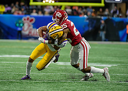 LSU Tigers wide receiver Justin Jefferson (2) is tackled by Oklahoma Sooners safety Justin Broiles (25) during the first half in the 2019 College Football Playoff Semifinal at the Chick-fil-A Peach Bowl on Saturday, Dec. 28, in Atlanta. (Vasha Hunt via Abell Images for the Chick-fil-A Peach Bowl)