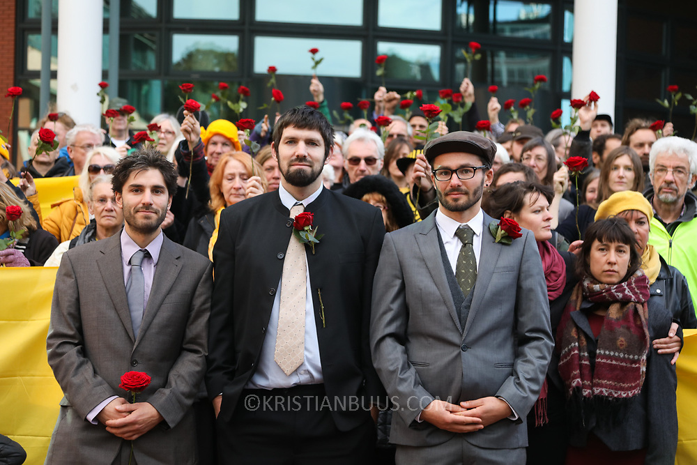 """Outside Preston Crown Court, shotly before sentencing of the Frack Free Four. Simon Roscoe Blevins, 26,  Richard Loizou, 31, Richard Roberts, 36 and Julian Brock, 47During a mass protest by locals and supporters in July 2017 which spontaneously brought a truck convoy bound for Preston New Road to a halt, the four climbed onto lorry cabs and stopped truck movement for four days.<br /> <br /> Supportive locals aided the action by throwing up blankets, food and water to keep the protestors in place and prevent trucks from entering the drilling site. After a seven day jury trial at Preston Crown Court in August 2018, the four men were found guilty of Public Nuisance. Judge Altham has told them to expect """"immediate custodial sentences"""" on 25th September 2018."""