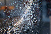 Smashed glass window on 5th November 2020 in Birmingham, United Kingdom. Tempered or toughened glass is a type of safety glass processed by controlled thermal or chemical treatments to increase its strength compared with normal glass.