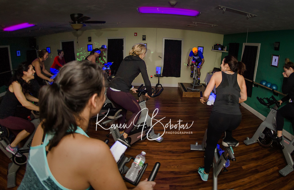 """Kale Poland leads the charge during the first hour of the 12 hour """"Bike-a-Thon"""" at Body Design by Joy to raise money for NH Easter Seals Drug Prevention and Substance Abuse Programs.  (Karen Bobotas/for the Laconia Daily Sun)"""