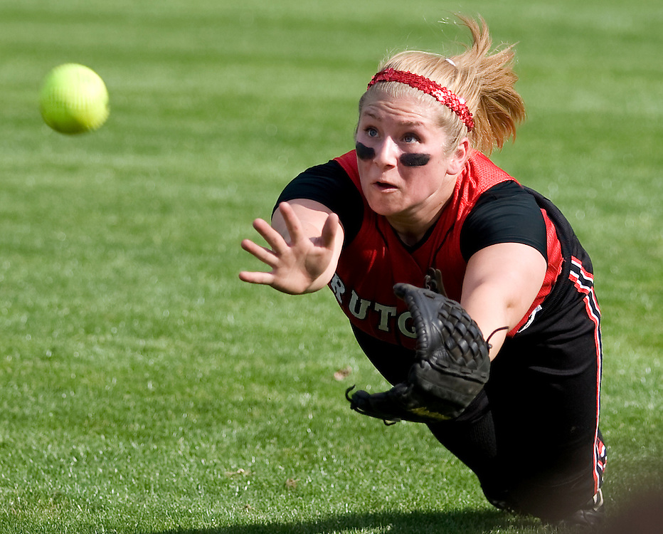 [date} 5:56:00 PM --- SOFTBALL SPORTS SHOOTER ACADEMY 005 ---Rutgers University right fielder Christine Royland dives for a ball during the 2nd inning of a softball game against Virginia Tech University. Virginia Tech went on to win the game by a score of 9-0. Photo by John Birk, Sports Shooter Academy