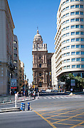 Historic cathedral framed by modern buildings, Malaga, Spain viewed up Molino Laria street