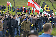 Nov. 11, 2015 - Wegscheid, Bavaria, Germany - GERMANY, Bavaria, Wegscheid; <br /> <br /> Patriotic local Austrians and some supporters of theirs from over the border in nearby Slovenia gather for an anti-immigration rally, as an opposing left wing pro-refugee rally approaches.  The encounter takes place in high in the wine-producing hills and farms of this alpine region which lies on the border of the Slovenian town of Sentilj where a vast refugee processing centre has led to raised tensions around the issue.<br /> ©Exclusivepix Media