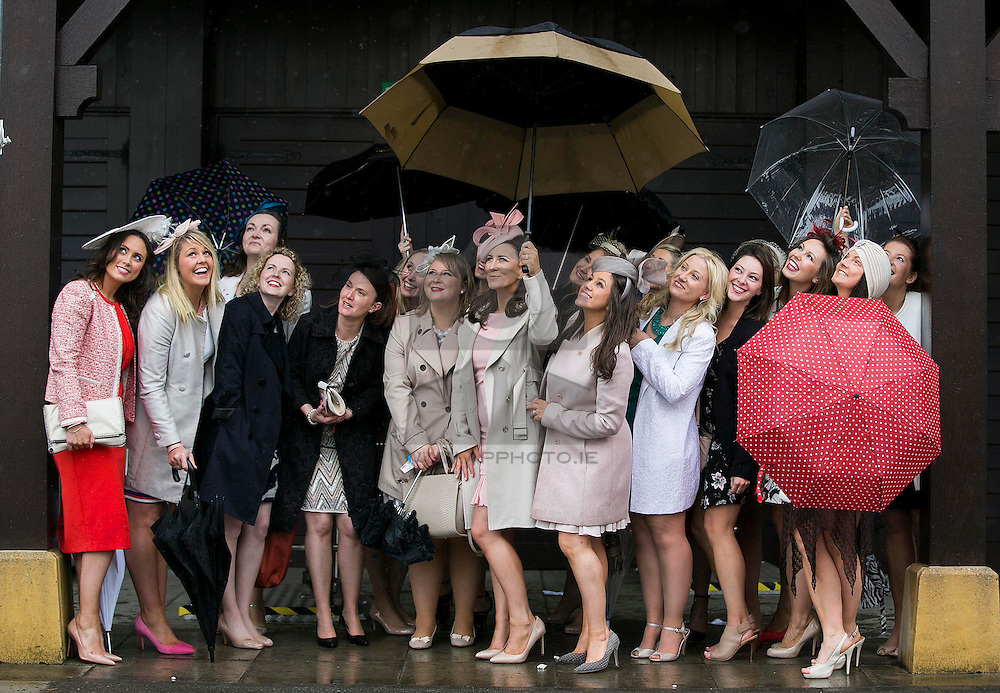 Repro Free: 02/05/2015 Davinia Kingston from Cork (centre) is pictured with her fellow hens checking out the going at the final day of the Punchestown Racing Festival. Picture Andres Poveda
