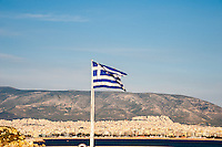 Piraeus, Greece.  Athens in the background.