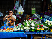 08 AUGUST 2018 - BANGKOK, THAILAND: A flower garland seller at Khlong Toei Market in Bangkok. It is the largest market in Thailand.     PHOTO BY JACK KURTZ
