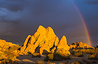 The rainbow was contrasting strongly with the dark storm clouds and sunlit rocks. But seconds later, it faded away as the sun went behind the clouds.<br /> <br /> Date Taken: August 20, 2014