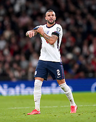 England's Kyle Walker puts on the captain arm band after team-mate Harry Kane is substituted on during the FIFA World Cup Qualifying match at Wembley Stadium, London. Picture date: Tuesday October 12, 2021.