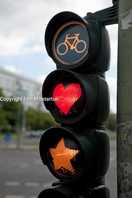Traffic lights for cyclists painted to show red heart and yellow star in Berlin 2009